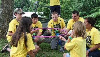 children playing with camp counselors