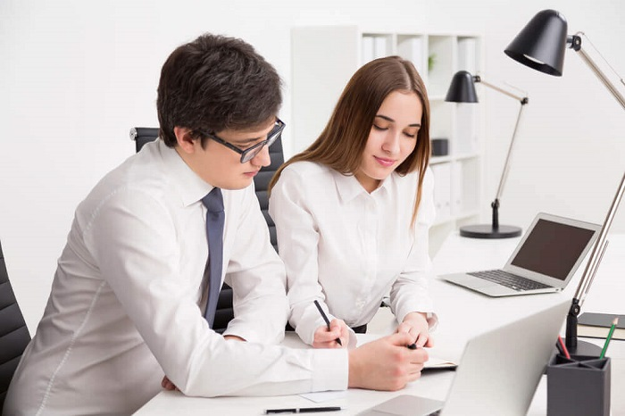 lawyer and paralegal working