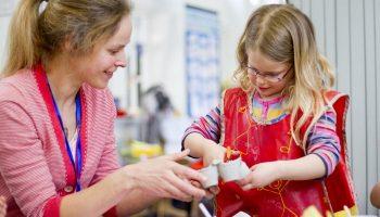 child and her art teacher