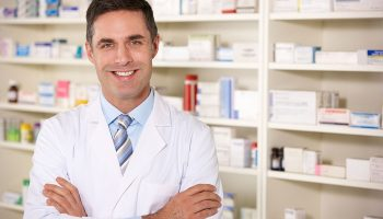 pharmacist in front of a shelf