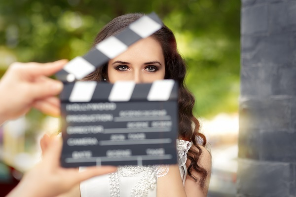 actress behind a movie clapboard clapper