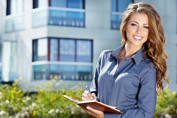 woman assistant property manager smiling