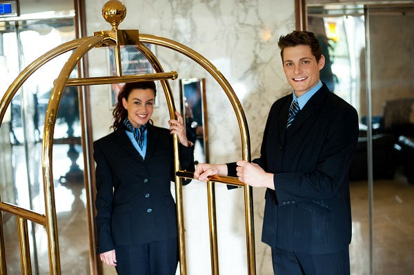 luggage cart manned by hospitality workers