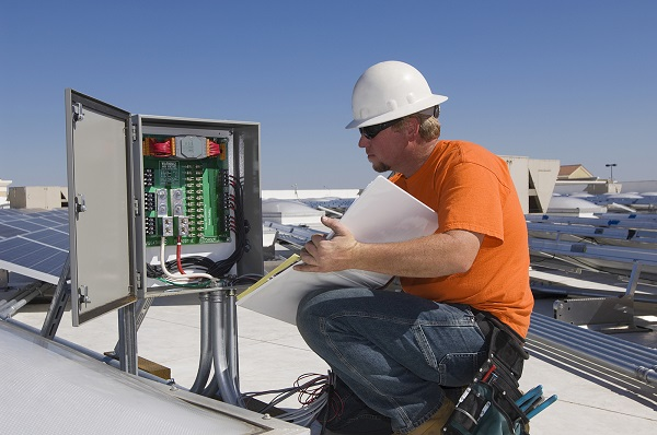 electrical engineer working at electricity box
