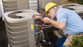 worker fixing HVAC
