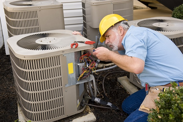 worker fixing HVAC