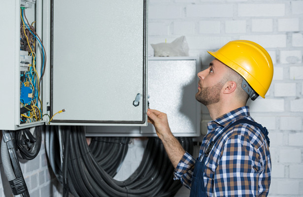 electrician performing maintenance work